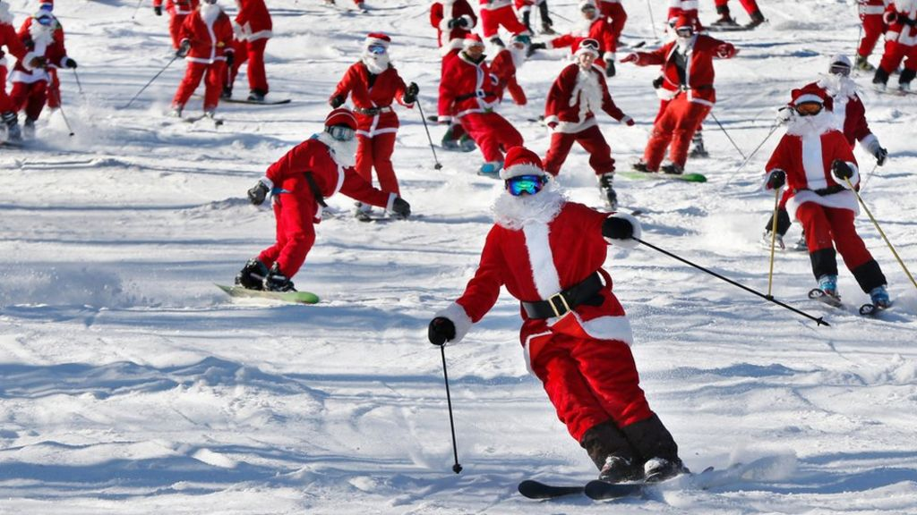 Skiing Santas take to the slopes in Maine - BBC News
