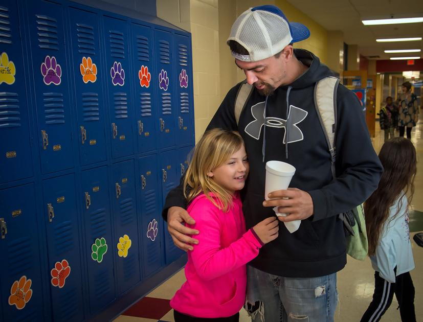 Donuts with Daughters connects parents, students at Spring Hill Intermediate School