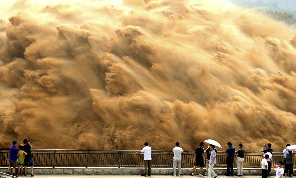 Open the floodgates: Millions of tonnes of silt forced downstream through giant dam in China