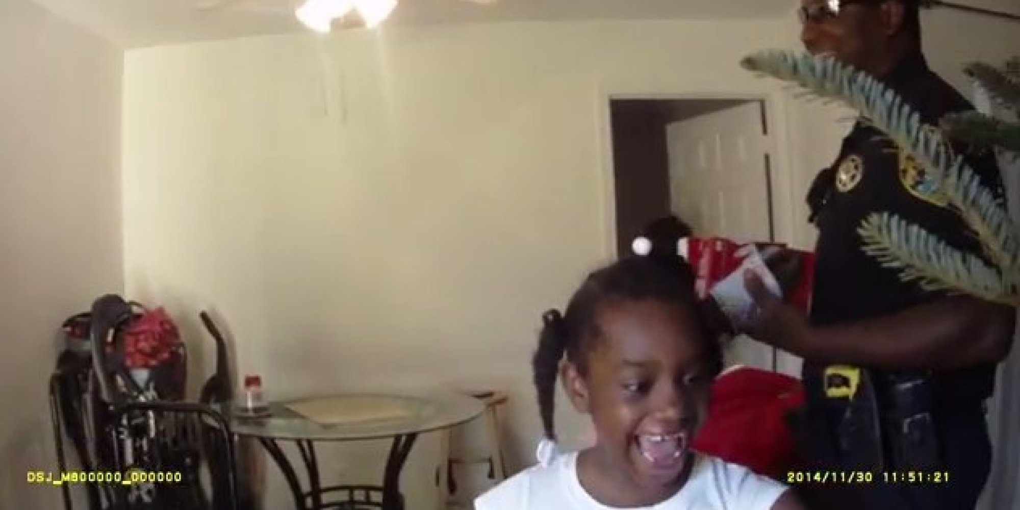 Watch Police Surprise Needy Family With Christmas Tree After Answering Their 911 Call