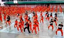 Psy's Gangnam Style performed by Filipino prisoners – video