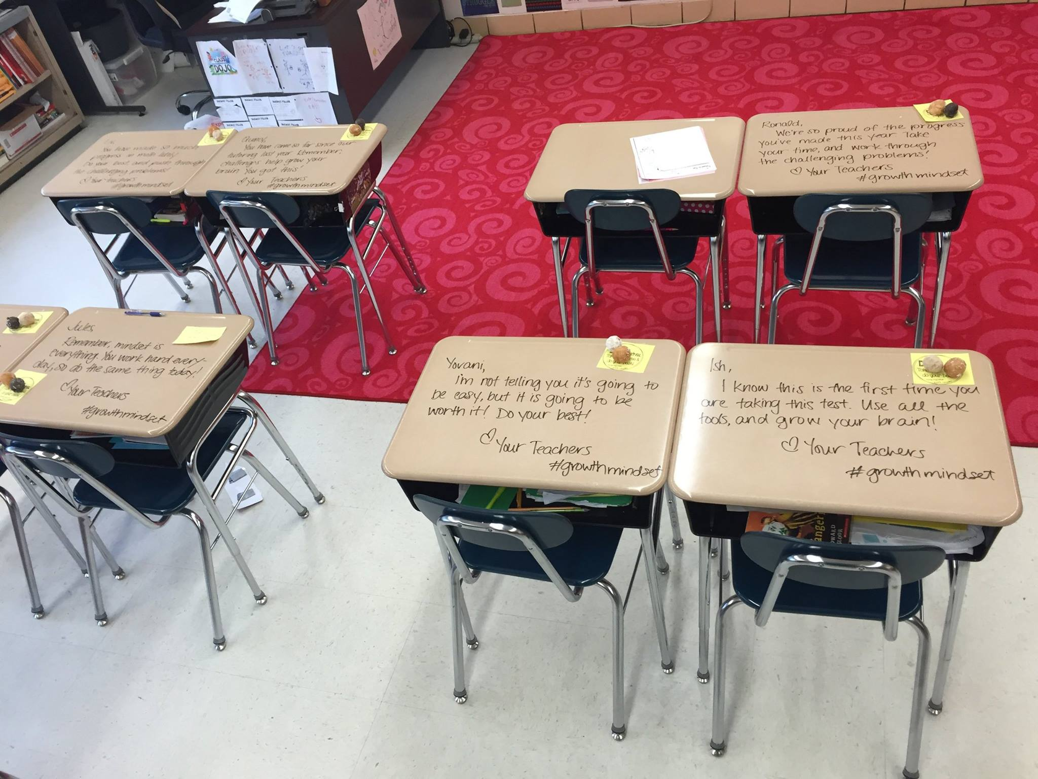 Teacher turns students' desks into letters of inspiration - 680 NEWS