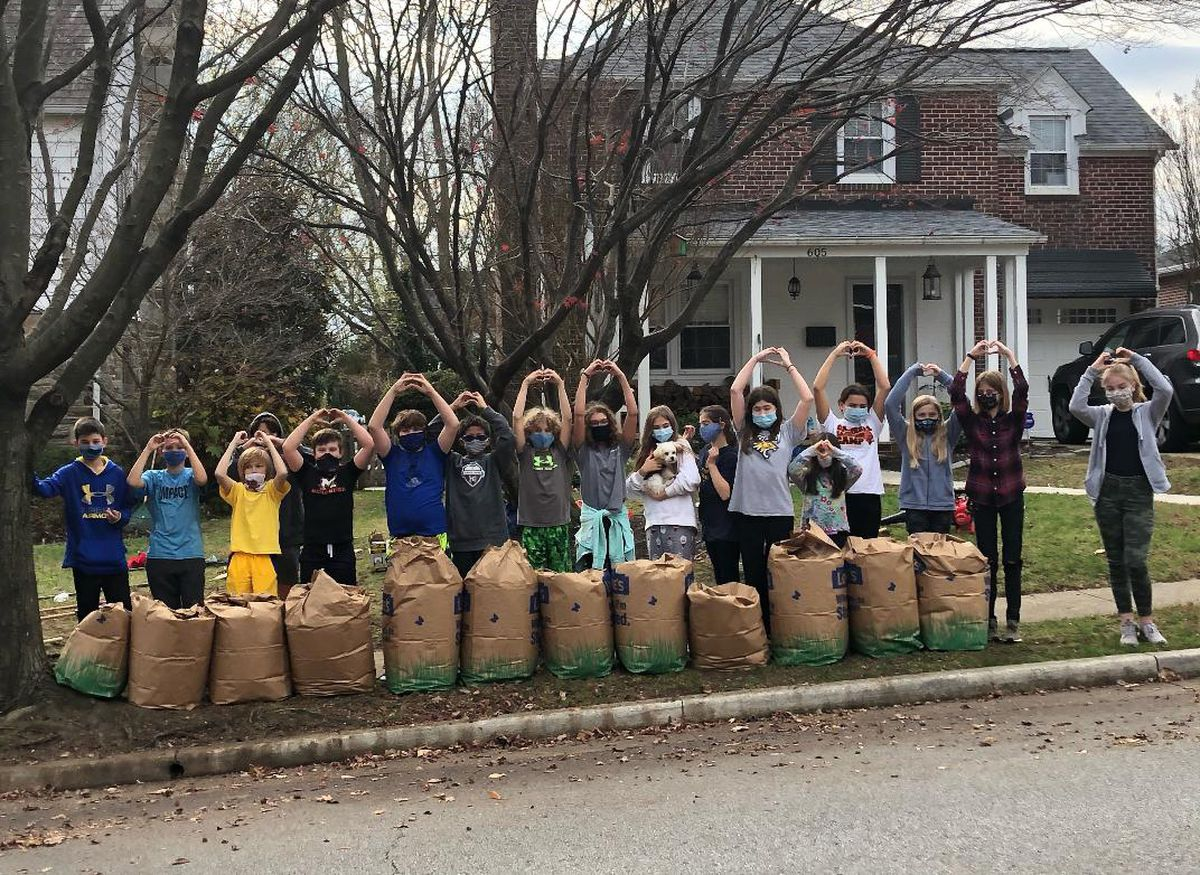 Kids Charity Club rakes in leaves and money in memory of a Stoneleigh Elementary bud