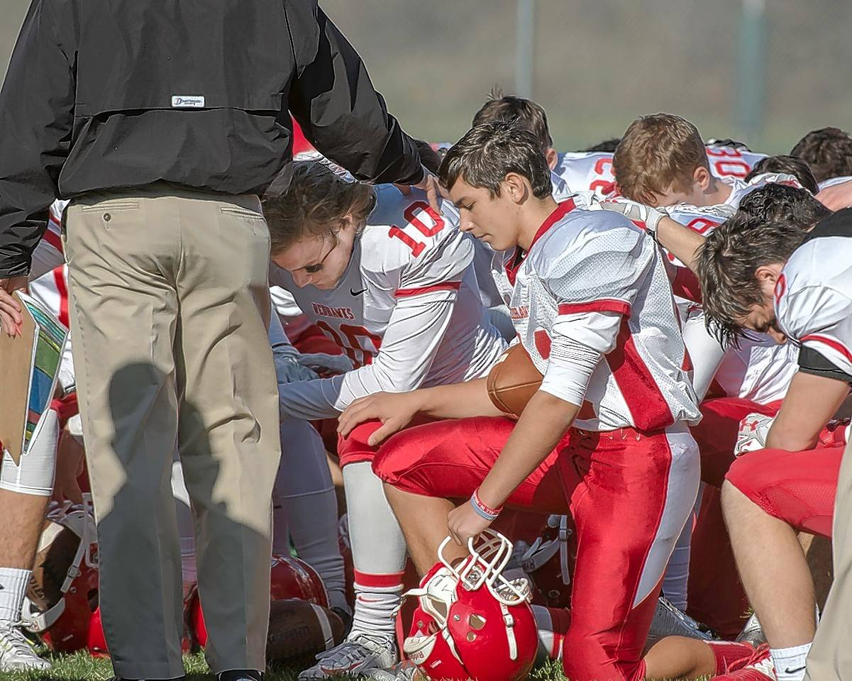 Naperville Central coach told he can't lead players in prayer